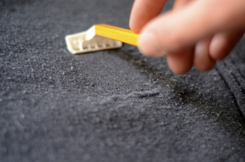 One of the best ways to de-pill winter coats and sweaters is by gently rubbing them with a pumice stone, then removing them with a lint roller.